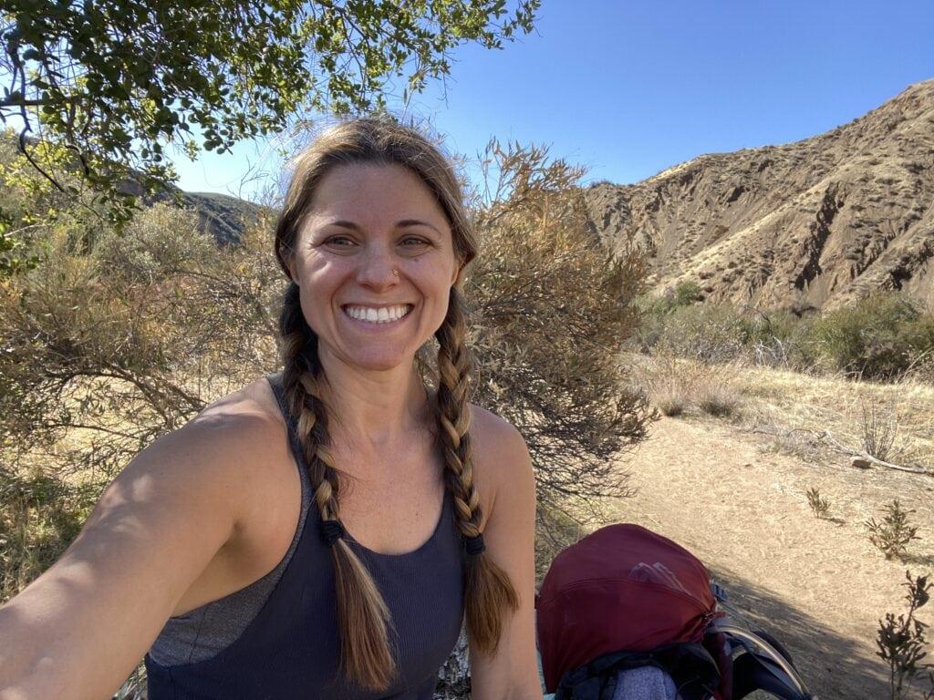 Sera Melini smiling on Sespe Wilderness trail